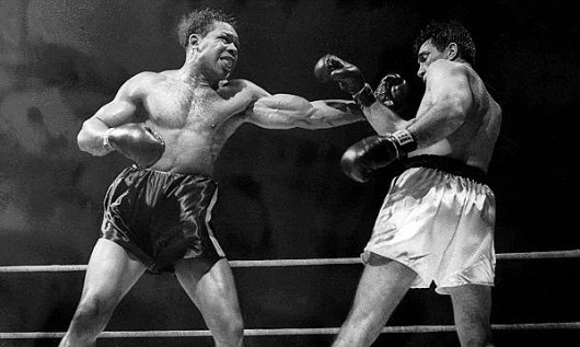 Archie Moore (left)